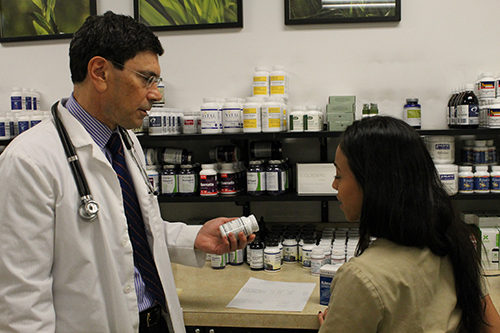 Dr. Hoffman personally selects the highest quality nutritional products for our Fullscript Supplement Dispensary – here with Grimaldy Vargas, Supplement Manager.